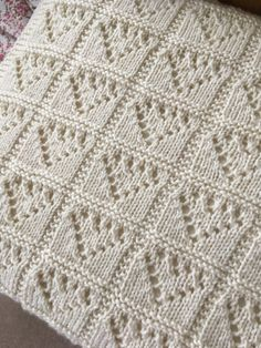 Knitting Pattern for Lace Hearts Baby Blanket - The finished measurements are 73cm x 60cm. Worsted weight yarn. Designed by KnitSewMake