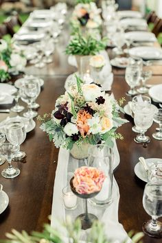 Teak dining tables, white sheer table runner and a mint & apricot flower theme