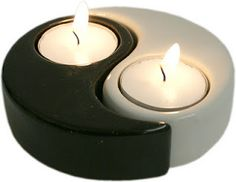 """Yin Yang Candle Holders. """"There is a perception (especially in the West) that yin and yang correspond to evil and good. However, Taoist philosophy generally discounts good/bad distinctions and other dichotomous moral judgments, in preference to the idea of balance. Confucianism did attach a moral dimension to the idea of yin and yang, but the modern sense of the term largely stems from Buddhist adaptations of Taoist philosophy."""""""