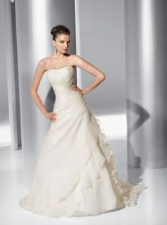 Illusions Style 3141 by Demetrios - Size 2 - 28 Satin organza, A-line wedding gown with a strapless neckline. This bridal dress has a wrap bodice, side draping, and chapel train. Bolero jacket is included. Available Colors: Ivory, White