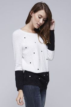 Must have super soft color block sweater. Black and white color block sweater with polka dots.