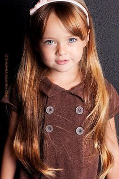 Looking for a good haircut with bangs for Aubri. Really don't want to cut her hair off.