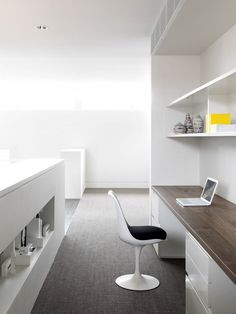 Interior Design Idea - 13 Examples Of Desks In Hallways // A large home office sitting at the top of the stairs has lots of work space, ample storage solutions, and a warm wood desk top to make the spot feel cozy and inviting.