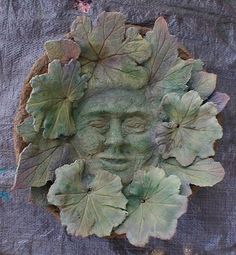 "Make this concrete face in leaves! ~~Just an image so we're on our own as to ""how"". If I figure out an easy way, I'll post it. Cement Art, Concrete Crafts, Concrete Art, Concrete Projects, Concrete Garden, Concrete Planters, Garden Crafts, Garden Projects, Concrete Leaves"