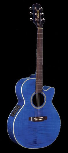 His blue sunburst guitar sat on its pedestal ~ Very similar to the one I have. Mine is shinier