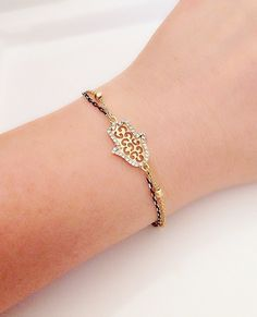 Check out this item in my Etsy shop https://www.etsy.com/listing/192311158/gold-hamsa-hand-braceletanklet