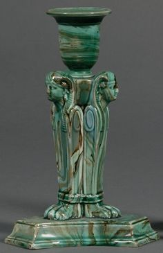 Pair of Wedgwood Green Glazed Egyptian Candlesticks, England, c. 1865, each with a green glazed solid agate body modeled with three sphinx monopodia, impressed marks, ht. 6 3/4 in.  |  SOLD $1,185 Skinner Auction