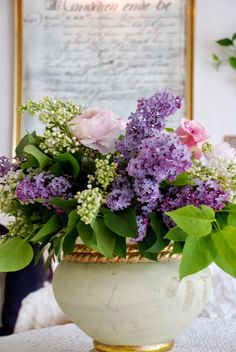 Beautiful Floral Arrangement with purple lilacs and pink roses
