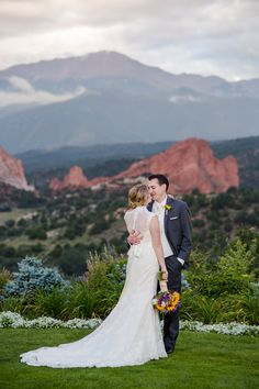 Amazing view!  Lovely, elegant, romantic bride and groom against the red rocks and blue mountains of Pikes Peak.  Wedding at Garden of the Gods Club in Colorado Springs, CO Jon loves Laura Photos by Katie Corinne Photography