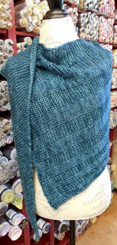 """This long, triangular shawl is shaped by inserting stockinette stitch stripes into the body of the shawl. The shape of the shawl is a right triangle - start knitting at the point and keep going until you finish the chart. The i-cord edge is knit along with the body of the shawl, so there is no picking up or seaming at the end. There is only one size to this shawl - 76"""" long x 25"""" wide; however, the size can be adjusted by changing yarn or needle size. The gauge is not overly important. When…"""