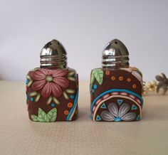 "1"" salt and pepper shakers decorated in polymer clay."