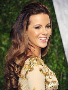 Kate Beckinsale's half up curled hairstyle with bronzed cheeks and pink lipstick | allure.com