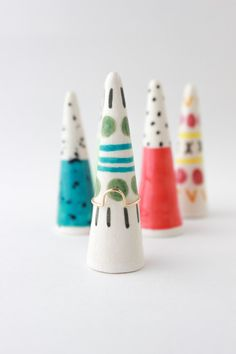 Really awesome Etsy listing at https://www.etsy.com/pt/listing/236300904/patterned-ring-cone-ceramic-ring-cone