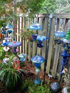 Painted glass garden totems