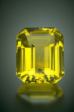 Orthoclase can be found as a transparent colorless, champagne, or yellow gem resembling citrine quartz or yellow beryl. This 250-carat gem is rare because of it's size, transparencyand vibrant yellow color. From Madagasgar, the most important source of facet grade yellow orthoclase ( a member of the feldspar family)