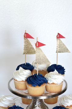 Come sail away with these charming handmade sailboat toppers - each topped with a tiny little red flag! We make each sail topper from vintage book paper, cardstock and a 6 bamboo pick, making them a delightful way to turn your cupcakes into mini sailboats, so cute and definitely a show stopper! Would you like different colors? Just let us know - we love custom orders! And if you are looking for cupcake wrappers, these pair wonderfully with our Navy and White Anchor Wraps…