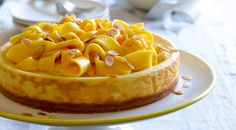 Top of a superb Christmas lunch with Curtis' almond ricotta cheesecake with sensational fresh mango.