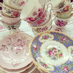 Mismatched and stacked teacups and saucers. www.thewhimsicalrose.com