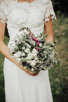 Beautiful bridal style + bouquet from this Norwegian mountain wedding  | Image by  Lieben Photography
