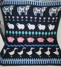 This is a vintage throw blanket from the 1980s with a farm animal themed patterned into a sampler style. During the 1980s the rage was country everything and this blanket has it all. Farm animals where on everything and homes were bursting with country crafts. This was made in the late