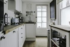Scandinavian inspired home with an all-white colour scheme and simple decor with ideas for how to decorate a rented house
