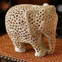 Floral tendrils envelop a demure mother elephant in this soapstone from Gulam Rasool of Elephant Parade, Elephant Love, Elephant Art, Elephant Sculpture, Sculpture Art, Sculptures, Elephant Home Decor, Soapstone Carving, Power Animal