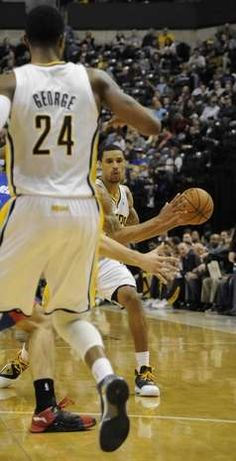 Indiana Pacers forward Paul George  looks for the pass from teammate guard George Hill
