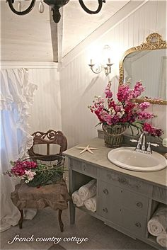 FRENCH COUNTRY COTTAGE: Petite Cottage Bathroom Makeover...cubbies for the towels, chair with the flowers, silver ad grey.