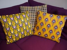 gorgeous sofa cushions by Coggon in her deco fans, feathers, and flowers fabric collection