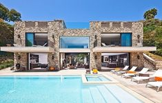 Awesome Modern Castle-Like House On The Beach : Modern Castle With Stone Walls Big Window Door Chair Table Orange Pillows Outdoor Pool Sofa . Malibu Mansion, Malibu Beach House, Beach Mansion, Miami Beach, Malibu Homes, Beach Pool, Mansion Homes, Modern Castle, Malibu Beaches
