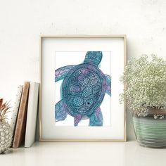 Bring beach vibes to your home decor with this sea turtle print. It features a hand painted teal and purple background with a tribal pattern design on top.