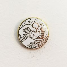 "1"" quality hard enamel gold plated pin. Comes individually packaged with deluxe clasp. Designed by Liam Ashurst."