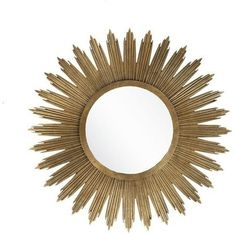 Meant to be the center of attention in any room, our large round sunburst gold mirror is beautifully styled. The sturdy metal frame is finished in brushed gold. The ornate detail inspired by art deco