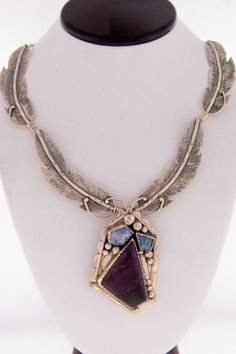 Navajo Sterling Silver Feather Necklace | Sugilite and Boulder Opal Pendant | Authentic Native American Jewelry. I love it! Great artwork.