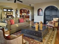 This warm living room exudes true Mediterranean-inspired elegance through its structure and decor. With dramatic interior architectural elements, the living room design is kept simple yet refined with a touch of Old World Spanish flair. Design by Vanessa DeLeon