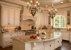 Elements of a French Country kitchen. Glazed painted cabinets. Arched window. Corbels under the island. And range hood all add to the feel and style. Try adding these to what you already have.