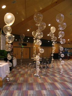 Bubble strands for a reception, New Years Eve, etc. Hang them from the ceiling in clusters or like the pic by the dance floor! Or you can do that for a pool party or mermaid party as bubbles Balloon Decorations, Wedding Decorations, Balloon Ideas, Wedding Ideas, Diy Dance Decorations, Bubble Guppies Decorations, New Years Eve Party Ideas Decorations, Mermaid Birthday Decorations, Banquet Decorations