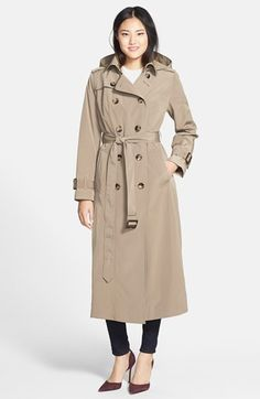 Free shipping and returns on London Fog Long Trench Coat with Removable Hood (Online Only) at Nordstrom.com. The classic double-breasted trench, complete with button-down flaps and belted cuffs, gets an extra layer of weather protection from a detachable hood and heavy satin lining.