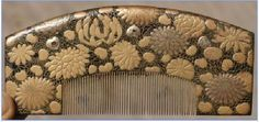 Edo period larger black lacquer comb decorated with kiku in takamakie and gold. Comb No BL5