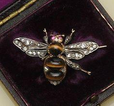 A tiger's eye and diamond bee brooch