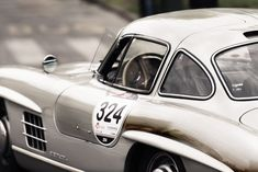silver 324 vintage car shallow focus photographyu preview