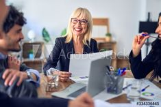 Group of business workers smiling happy and confident. Working together with smile on face using laptop and speaking at the office - Buy this stock photo and explore similar images at Adobe Stock Buy Office, Working Together, Menu Templates, Confident, Adobe, Polaroid Film, Laptop, Printable, Smile