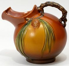 wow. i have the same pattern/color in a gorgeous bowl. 1931 Roseville Brown Pinecone Art Pottery Pitcher
