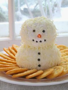 Cheese Ball Recipe 2 - 8 ounce packages of cream cheese 1/2 cup finely shredded mozzarella cheese 1 clove of garlic, minced (optional) Mix the garlic (if desired) into the cream cheese. Roll cream cheese into two balls, one smaller than the other Roll each ball in the finely shredded mozzarella cheese. Build your snowman. Add peppercorns for eyes, mouth, and buttons. Arrange on a plate with crackers, bagel chips, etc. snowman made from cream cheese