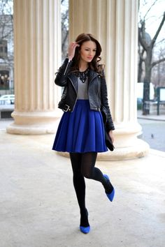 Fall/ winter outfit ideas. Black leather jacket. Grey sweater. Cobalt blue skirt/ shoes. Black tights. The Best Street Style Looks Every Girl Should Try