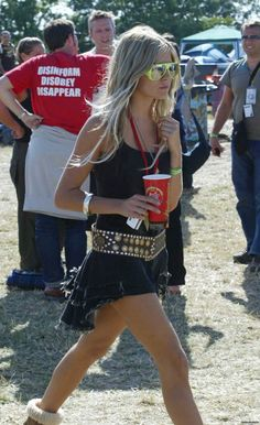 Sienna Miller at Glastonbury in a Plein Sud dress and nu-rave sunglasses. Festival perfection!