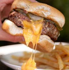 Recipe for Juicy Lucy Burger - These cheese-stuffed burgers ooze cheesy goodness with every bite—and now you can make your own at home. Be sure to aim any cheese drips over your French Fries.
