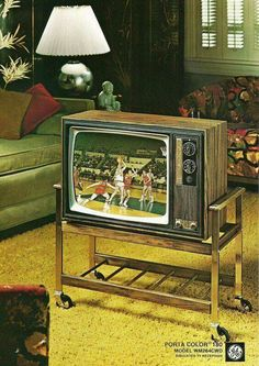 1970 General Electric Portable Color Television (the living room is alot fancier than ours was, but same TV stand)