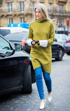 Try wearing a midi dress layered over a pair of skinny jeans