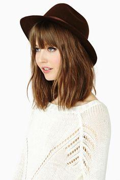 Cute shoulder-length hair, with bangs.